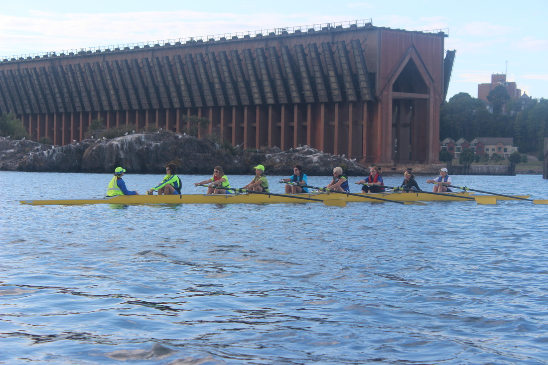 Upper Peninsula Community Rowing Club (UPCRC) rowing in Marquette's Lower Harbor
